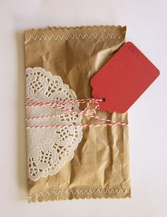 Gift wrapping with kraft paper, doily, baker's twine, and tag, zig zag stitch on both ends of package. #packaging
