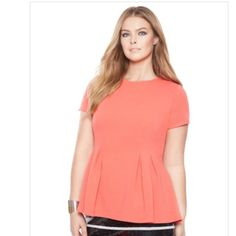 Eloquii Modern Peplum Top Sz 18 Poly knit stretch. Thick, quality material. Eloquii calls the color sorbet but it is really a bright coral color as seen in the last picture. I wore this a couple of times and decided it really is not right for me so it is essentially new. No flaws. Eloquii Tops Blouses