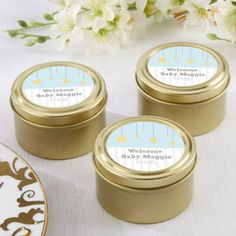Give your baby shower guests the royal treatment by handing over these personalized gold round candy tins.
