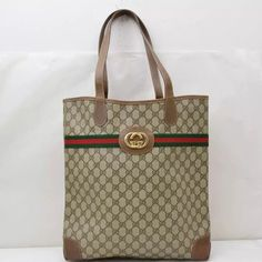 """Rare Gucci Canvas tote 100% authentic Vintage Gucci tote! Made in Italy. Canvas is in very good condition. Straps has signs of use but no tears or cracks. Bottom has minor rubs as shown in the picture. Interior has signs of use but overall still in good condition bag and very timeless. Measurements : Length 14.5"""" Height 15.3"""" dept 3.54"""" . Check out my other items. Bundle and save. Gucci Bags Totes"""