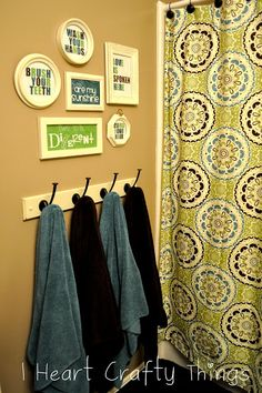 I HEART CRAFTY THINGS: Bathroom Printables...love the frames but mostly the towel rack for boys