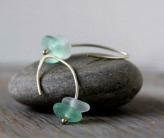 Hand formed, sterling silver earrings with sea glass.