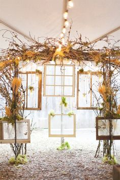 Cool use of old frames and windows for wedding ceremony backdrop