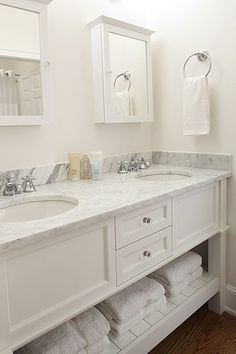 Lovely white and gray bathroom features double vanity boasting white flat panel cabinets topped with Calcutta Caldia Marble Countertops framing his and her sinks under white framed medicine cabinets. Beach House Bathroom, Small Bathroom Sinks, Retro Bathrooms, Diy Bathroom Vanity, Small Bathroom Storage, White Bathroom, Amazing Bathrooms, Master Bathroom, Bathroom Marble