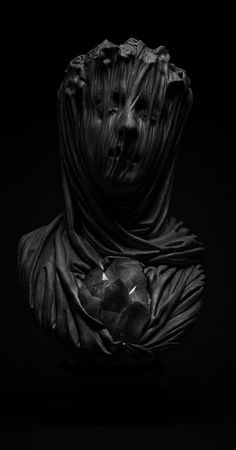Hauntingly beautiful sculpture by Livio Scarpella. The way that this sculpture was photographed is what makes it more appealing, but it gives me a sense of anguish  and hard to look away.