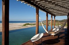 At Hotel Escondido by Federico Rivera Río, chairs alternate with cotton hammocks by the pool. Beach Hotels, Beach Resorts, Hotels And Resorts, Luxury Hotels, Ad Mexico, Les Continents, Surfer Style, Thatched Roof, Interior Design Magazine