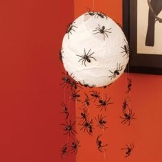 Scary Spider Hatchlings - 40 Easy to Make DIY Halloween Decor Ideas.  With a large white balloon – which will look like a spider's nest- and a few of those cheap spider rings, you can create a very scary looking spider nest. Just use the balloon for the nest and have the spiders crawling all over it. Cheesecloth cut into strips will give it a spider web quality and can be draped down so that the spiders can crawl toward the floor.