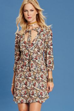 Forever 21 Contemporary - A woven mini dress featuring a floral print, tie-neck…