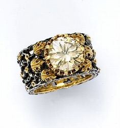 Vintage Buccellati Ring, 4 carat diamond of unusual and mysterious color that echos the gold and silver tones of the setting.
