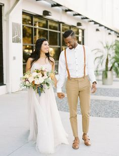 Refined Bohemian Inspiration // groom in suspenders and taupe with leather accents