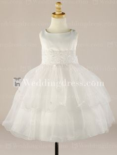 Flower girl dress features in Satin & Organza. Waistline is comprised of Lace with pearl and sequin accents.