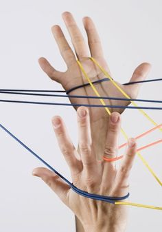 Cat's Cradle - who doesn't remember the string fun we had? Who needed high tech gaming systems when we had string? LOL