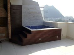 Clean lines, setting with a view and it a project you could do. Get hot tub building information at www.custombuiltspas.com