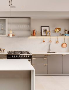 minimal neutral kitchen with brass & copper accents