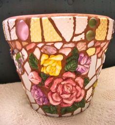 China mosaics on tera cotta pot, available at Precious Times, Redlands