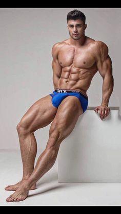 Sexy muscular hunk enjoys