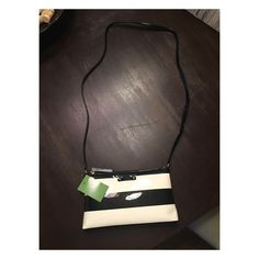 Kate Spade Cross Body Bag ♠️ Super cute Kate Spade cross body. Black and Cream patent leather. Never been used- still with tags. Makes a great gift! kate spade Bags Crossbody Bags