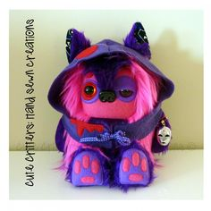 I love this Zombie Yeticub SOOOOOO stinkin' much!!! 1) I collect masks and he/she is wearing a mask charm 2) I love Zombie toys & cute Zombies 3) I am obsessed with Alice in Winderland and his/her colors remind me of Cheshire!!!    $65.00 Viper Yeticub by CuteCritters on Handmade Australia