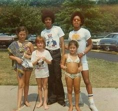 Michael & Marlon Jackson with some fans.