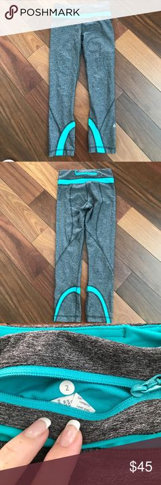 EUC  Lululemon grey/teal legging size 2 EUC Lululemon grey/teal size 2 cropped leggings. Beautiful heathered grey color with teal green band, zipper and accents. lululemon athletica Pants Leggings