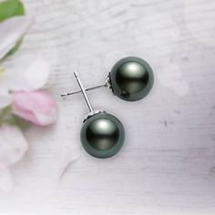 A modern touch on an essential Mikimoto design is the Black South Sea cultured pearl stud. #Mikimoto #BlackSouthSea