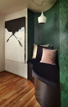 A Ziggy pendant from Arteriors Home hangs over a curved nook that Dirkse covered in green Cole & Son wallpaper. (Benjamin Benschneider/The Seattle Times)