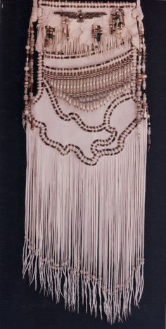Thunder Bird Bag. White deerskin with Antique Navajo silver. Made by Carole Hook.