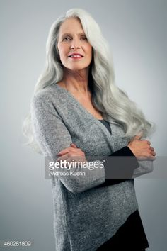 Stock Photo : Mature woman with long, gray hair, standing.