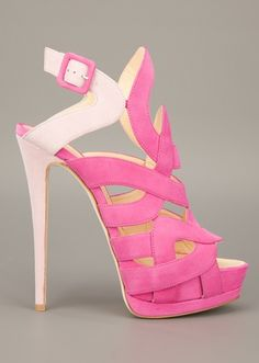 """I already talked about this particular shoe when Nicki Minaj was wearing them in blue, but this time is available in pink version. Is called """"Oleandro"""" and it comes from Giuseppe Zanotti spring/summer 2012 collection. Featuring multi strap design, contrasting colors of pink, and fastening buckle.  Click here to buy."""
