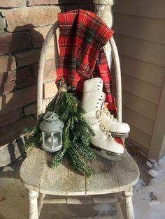 My front porch winter vignette.  Thrift store skates & scarf, bundle of pine & lantern.