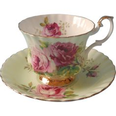 Vintage Royal Albert English bone china standard cup and saucer unnamed pattern, lush pink roses on a minty green ground, gold trim. On the rim of the