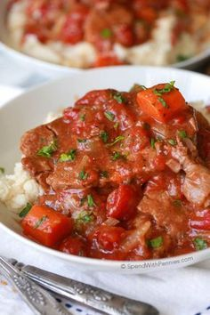 Swiss Steak is a perfect family dinner; it's easy to make and can be cooked either in the oven or in the slow cooker. This dish has delicious tender beef in a rich tomato gravy and is perfect served over rice, noodles or mashed potatoes!
