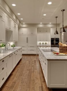 Cabinets are White Dove, by Ben Moore. Island is White kashmir (3cm granite)alternative to marble - granite counter tops in kashmir white... Bianco with a glass tile backsplash.  Wish my kitchen could be this size!!!