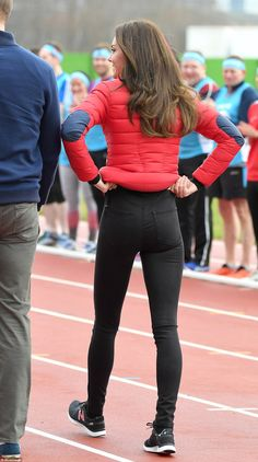 Giving Pippa a run for her money! The Duchess has to readjust her jeans after her enthusiastic efforts in the relay race this afternoon showcasing her pert derriere