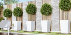 gartendesign ideen Clad in a glossy white paint, the Llio Small Planter in White is the perfect pot to showcase your favorite flowers and house plants. Place on an Clad in a glossy Modern Garden Design, Backyard Garden Design, Small Backyard Landscaping, Minnesota Landscaping, Garden Wall Designs, Stone Landscaping, Modern Landscape Design, Driveway Landscaping, Compound Wall Design