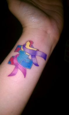 Breast Cancer, Autism and Alzheimer's Ribbon..i love my tattoo