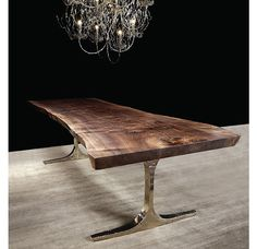 Cast bronze and Walnut slab dining table by Hudson Furniture Inc.