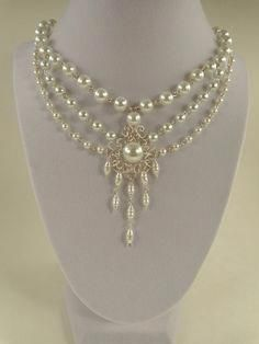 This beautiful and elegant necklace displays an array of shapes and sizes of white pearls with a central, chandelier style setting, for Bead Jewellery, Beaded Jewelry, Handmade Jewelry, Beaded Necklace, Jewellery Stand, Personalised Jewellery, Hair Jewellery, Pearl Necklaces, Statement Necklaces