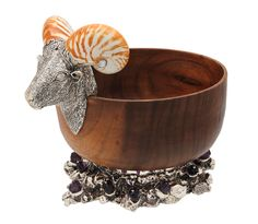 Wooden bowl with ram head We believe in working with nature and the principals of holistic art depicting each significance of the natural existence. This mountain ram was no different, with Nautilus shell horns, standing atop a valley of amethysts and silver.  This charming piece can be used as a large fruit bowl for parties.