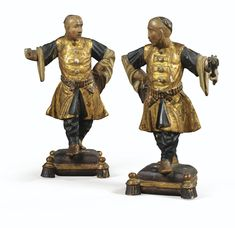 A PAIR OF VENETIAN MID-18TH CENTURY LACQUED AND GILT WOOD CHINESE SERVANTS