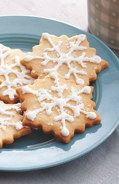 Sparkling sugar and white icing add festive elegance to these simple shortbread cut-outs. A beautiful cookie for exchanges, open houses or to share as a gift!