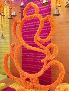 genda flower ganesh ji , genda flower ganpati , hanging bells , traditional decor , pooja decor , maata ki chowki decor