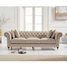 Holbrook Chesterfield 3 Seater Sofa In Beige Linen With Wooden Legs, features a classic and cosy design which is sure to make an impression in any living room setting. Upholstered in Beige Linen wi. Beige Sofa Living Room, Chesterfield Living Room, Living Room Sofa Design, Home Room Design, Home Living Room, Living Room Designs, Fabric Chesterfield Sofa, Beige Couch, Sofa Furniture
