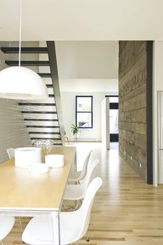 Wooden wall and great stairway against the brick feature wall!
