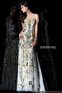 This gorgeous strapless chiffon gown is covered in sequins in an elegant pattern.