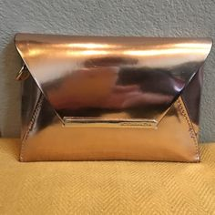 BCBGMAXAZRIA Mini Harlow Clutch in Rosegold Never Been Used! This rich-in-style rosegold clutch is the perfect addition to your social wardrobe. BCBGMaxAzria Bags Clutches & Wristlets