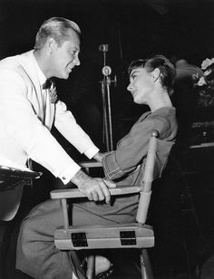 Audrey Hepburn and William Holden chat on the set of Sabrina, 1954.