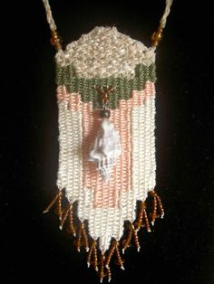 """""""Beach Dreams"""" - 2012 - Adjustable Length, Triton Shell centerpiece which was hand-collected by me on the Big Island of Hawaii, PERSONAL COLLECTION. Woven by Terri Scache Harris, theravenscache.shutterfly.com   Hand woven, handwoven, weaving, weave, needleweaving, pin weaving, woven necklace, fashion necklace, wearable art, fiber art."""