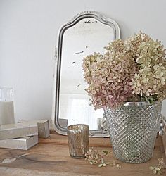 dried hydrangeas ... tea light ... vintage mirror