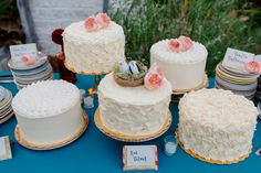 Instead of one tiered wedding cake, separate cakes with with same color icing but different on the inside. Reminds me of the county fair, expect to see prize ribbons.